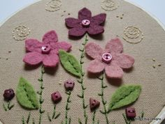 Woolly Pink Flowers wool felt flowers and buttons with embroidery on hoop. $26.00, via Etsy.