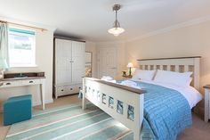 Brinyloft is a luxury self catering holiday apartment at Compass Point Apartments in Carbis Bay, Cornwall from Carbis Bay Holidays. Decor, Furniture, Luxury, Apartment, Home Decor, Holiday Apartments, Bed, Cornwall, Bedroom