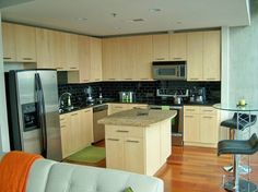 Maple kitchen cabinets, black onyx granite countertops, and rolling kitchen storage island available. Only selling the cabinets and granite as a set, but will sell island separately. All pieces are...
