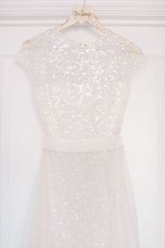 Reem Acra sparkling wedding gown with attached skirt // Maggie Harkov Photography