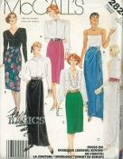 An unused original ca. 1986 McCall's Pattern 2824.  Misses' Skirt:  Front-wrapped Skirt A, B or C in two lengths has back gathers and waistband.  View A has front pleats.  View B has front pleats and drape.  NOTE:  Wrong side of fabric will show on front drape; purchase fabric which has pleasing appearance on both sides.  View C has front gathers and shaped hemline.