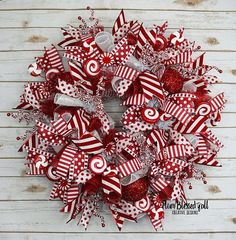 Fun and whimsical Deco mesh Christmas wreath adds a playful sense of fun to your front door or entryway this Christmas season and put a smile on guest face with its red and white candy cane theme. #Christmasdecor #Christmasdecorationideas #CandyCanewreath