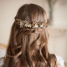 """This flower and gold vine comb headpiece from Etsy's AnnaMarguerite will complete the look for any boho bride. From """"Be a Glowing Goddess with these 10 Headpieces and Hair Accessories"""" on Intimate Weddings"""