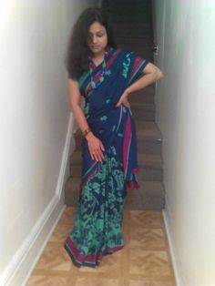 """""""I have taken this photo in my home sweet home with wearing this special saree i bought including the free gifts i got which was a special antique necklace. This photo is special because i loved this saree and I've wanting to wear this saree and take pictures of it while the newness lasts.""""  Jasica. United States"""