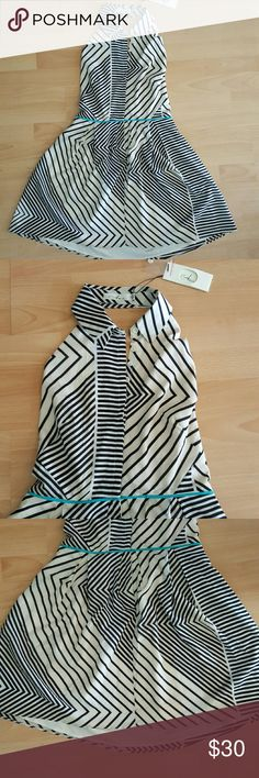 Striped Halter Dress New with tags size small ivory and black chevron/striped Halter Dress. Buttons up the front, elastic on the top back for some stretch and a pretty turquoise detail at the waist. Brand is Ara from Modcloth. Smoke free, dog friendly home. ModCloth Dresses
