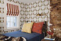 Michelle Smith Sag Harbor weekend home - mixing prints and patterns in a guest room with Thibaut's Cheetah wallpaper and vintage pillows from Round Top Antique Fair in Texas. Portrait of a Lady - Lonny