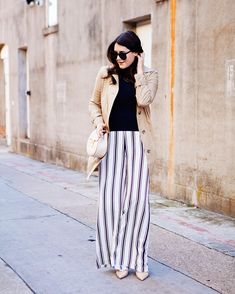striped pants with chic top and trench coat