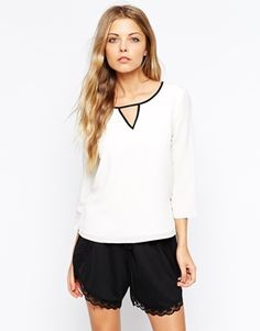 Vila V-Neck Wrap Top With Contrast Strap Detail- Make the plain white interesting! get it here: http://us.asos.com/Vila-V-Neck-Wrap-Top-With-Contrast-Strap-Detail/14sv20/?iid=4790044&cid=11318&sh=0&pge=1&pgesize=36&sort=-1&clr=White&totalstyles=262&gridsize=3&mporgp=L1ZpbGEvVmlsYS1WLU5lY2stV3JhcC1Ub3AtV2l0aC1Db250cmFzdC1TdHJhcC1EZXRhaWwvUHJvZC8.