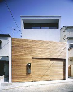 Wooden sliding garage door