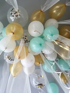 Tulle balloons for a gender neutral baby shower