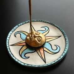 Check out my new Etsy page! Hand painted incense holder with sun/compass design. ONE-OF-A-KIND With gold face. $35.00, via Etsy.