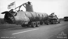 Wreck of the Japanese midget submarine sunk in Sydney Harbor aboard a truck enroute between Sydney and Melbourne during an exhibition tour to raise money for the naval relief fund, Australia, Nov 1942