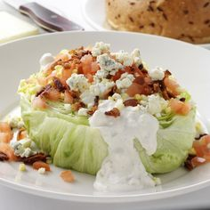 lettuce wedge with bacon,tomatoes, hard boiled egg and homemade bleu cheese dressing. Yummo!