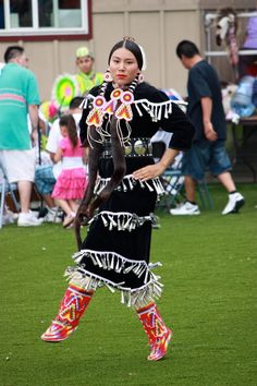 Jingle Dress Dancer: white ribbons on black to hold jingles