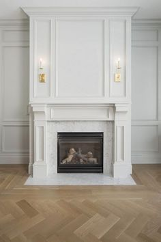 Wainscoting, herringbone floors, carrara marble fireplace surround, simple fireplace trim