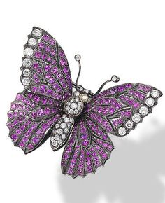 A pink sapphire and diamond novelty brooch The realistically designed butterfly, set throughout with circular-cut pink sapphires, highlighted by old brilliant-cut diamonds, width 4.2cm