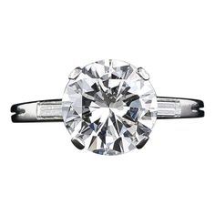 Circa 1960's classic, mid-century vintage diamond engagement ring by the eminent French joaillier - Boucheron. A bright and beautiful 3.05 carat round brilliant-cut diamond