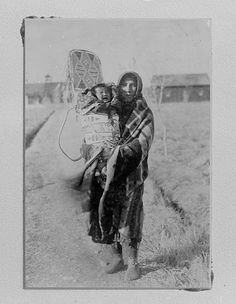 Stays High (the wife of Plain Feather) and their child - Crow - no date