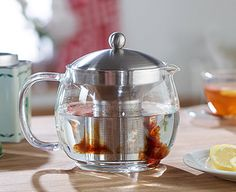 Glass tea pot with infuser makes brewing loose tea as easy as using a tea bag