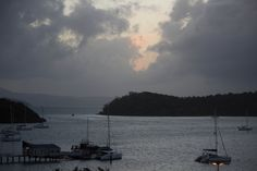 L1M1AP2 Sunrise. It took at while, but the sun finally arrives after a brief shower. Taken at Shute Harbour. Whitsaunday