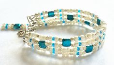 "Bracelet in cream, teal, turquoise, and silver, with ladybug charm, multi strand, 7.5"", adjustable by ShereesTrinketBox on Etsy"