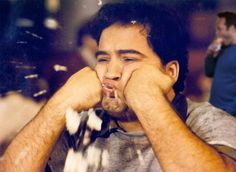 """Bluto (John Belushi): """"See if you can guess what I am now... I'm a zit. Get it?"""" -- from Animal House (1978) directed by John Landis"""