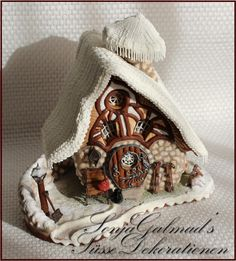 """Crooked Little Dwarf House under a """"Knitted"""" Blanket of Snow; gingerbread house (Lebkuchenhaus) decorated with royal icing"""