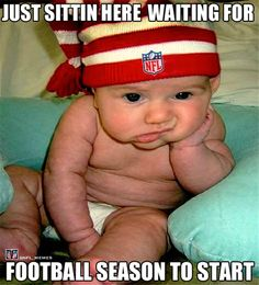 Cute baby waiting for football to start. (I love watching football but awful at playing it. :-)