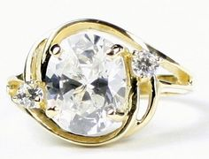 R021, Cubic Zirconia (CZ), 10KY Gold Ring * Stone Type - CZ * Approximate Stone Size - 10x8mm  * Approximate Stone Weight - 3.3 cts  * Jewelry Metal - Solid 10k Yellow Gold * Approximate Metal Weight - 3.9 grams  * Ring Size - Size selectable during checkout * Our Warranty - A full year on workmanship  * Our Guarantee - Totally unconditional 30 day guarantee
