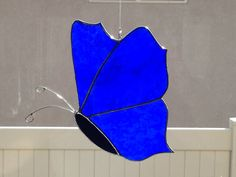 Stained Glass Irridized Blue Butterfly Moth Suncatcher by FoxStainedGlass on Etsy