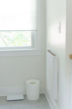 Faith & Mike's Master Bathroom:  The Big Reveal. I like the penny tiles, Ikea window shade and narrow heater.