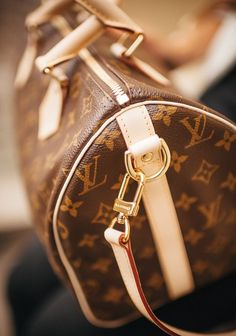 In iconic Monogram canvas, and with multi-carry options, the Speedy 35 with shoulder strap is a luxurious blend of modern chic and timeless style. | Speedy 35 With Shoulder Strap Only $214.99! | Louis Vuitton Handbags