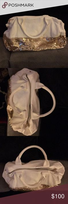 👛White & gold sequin handbag White vegan leather and gold sequin handbag--Deux Lux brand. It's purple inside with an inside pocket. Has handles and strap option. It does zip closed. The gold sequins circle the entire bottom third of the purse. It's a glam handbag for sure! It's never been used but does not have tags. However, it does have some pink scuff marks on the bottom (likely due to scuffs with a shoe from a boxed move; see photo). Otherwise in perfect condition. 16x10x7. Deux Lux…