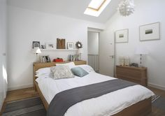 Headboard Shelf Contemporary Bedroom With Area Rug In United States Headboard Shelf Midcentury Bedroom with Wood Flooring in Orange County Bedroom