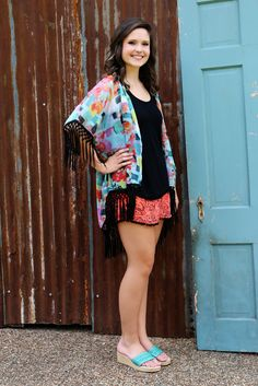 Everything's Coming Up Roses Kimono is a great asset to have in your closet, as so many colors give you so many choices!  Black fringe adorns the sleeves and hemline for a great contrast!