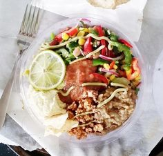Raw taco bowls from Charlie's Raw Squeeze. Cashew cheese, walnut mince, pulses (beans and lentils), salsa, raw veges -- corn, capsicum, greens, tomato? Template for making your own.
