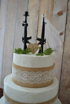 Machine gun weapon wedding cake topper army police themed hunting groom's cake Mr & Mrs sing the hunt is over gun decorations military sign