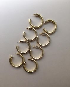 Gold hollow hoop earrings by The Hexad Jewelry. Large, chunky but lightweight. Also available in silver.