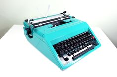 Vintage 1970's Cursive Typewriter by Olivetti Studio 45 Turquoise Made in Spain.