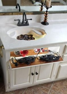 Built-in hair appliance storage with outlets!- this should be in every woman's bathroom!