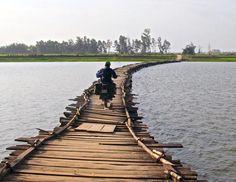 Photo Contest Winners for 2015 Calendar. Riding a floating bridge across Song Ba Ren River, Vietnam, on a Soviet Minsk