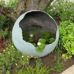 Spray the inside of your concrete sphere with Rust-Oleum LeakSeal and fill with water for a pretty water feature.