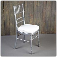 Silver Chiavari Chair - Shown with a tie-on chair pad available in black, white and ivory - order separately. Micro suede or Topaz seat pad covers also available separately.