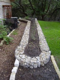 This is an unconventional style of edging, but is very easy to implement. You simply buy the cages, position them as you would like, then fill them with stones. They may not be aesthetically pleasing to everyone, but this style provides excellent drainage.ProsEasy constructionGreat drainageModularConsNot very prettyPotentialrusting of the cages