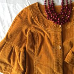 Corduroy Mini Dress or Coat EUC.  Mustard corduroy.  Bell sleeves; has a 70s vibe.  Can be worn as a mini dress or as a light coat.  Measures 16in across bust and 31.5 long.  I would say this is a S/M.  Has pockets.  Two buttons and two snaps across front.  Has a lot of stretch. lei Dresses Mini