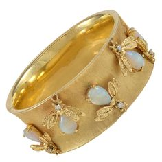 Opal Diamond Gold Bee Bangle Bracelet | From a unique collection of vintage bangles at https://www.1stdibs.com/jewelry/bracelets/bangles/