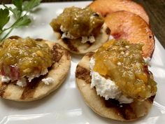 If you like sweet + 🔥 🌶️ you're going to love these Peach Tomatillo Salsa Rounds! 👉 Recipe: Husk and broil halved tomatillos in a toaster oven, along with another tray of halved and seeded chiles (we like Hatch chiles). Cook both until soft. Cool and add to a food processor, along with 1/4 cup of red onion, a dash of salt and a ripe peach. Puree till the consistency you desire. Toast Kontos Pre-Grill Cocktail Flatbreads, top with goat cheese and Peach Salsa. 😋 Food Inc, A Food, Peach Puree, Peach Salsa, Ripe Peach, Flatbread Pizza, Pita Bread, Halloumi, Seeded