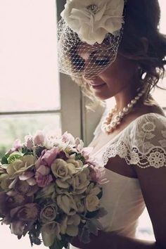 this is the birdcage veil that i'm in love with. huge flower, sweet veil.   I don't like normal long veils, but i feel the need to have some kind of veil even though i want a large flower and this is just the best of both worlds.