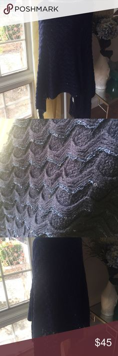 Indigo Fringe Poncho Beautiful blue Poncho... perfect for the holidays! Has sequins sewn into the knit for a little sparkle. Gorgeous knit chevron pattern. This is perfect to dress up or down!! One Size 💯 % Acrylic Sweaters Shrugs & Ponchos