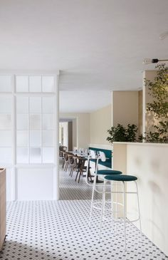 Danish studio Norm Architects has pared back the look of a typical Mediterranean interior to create a more Scandinavian aesthetic for this Italian restaurant in Copenhagen.